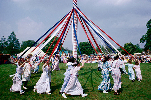 Some commeorate May Day by dancing around a Maypole and selecting a May Queen (Picture: Getty)